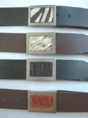 Leather belts with animal hide or shin inlay buckle